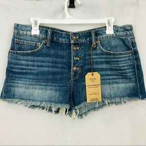 Lucky Brand • high waisted distressed denim shorts